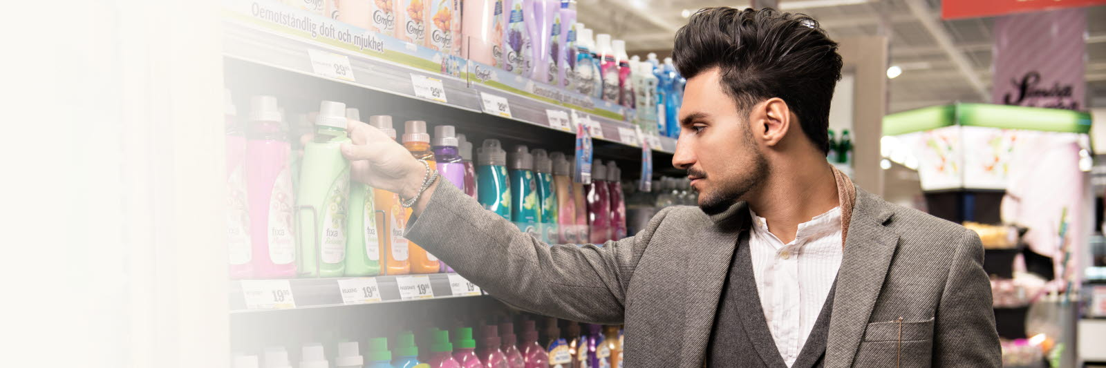 Man reaching for a product on a shelf