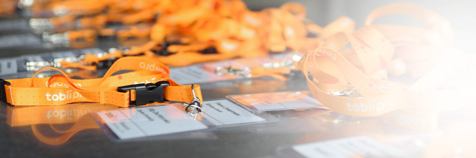 Tobii Pro conference badges on a table
